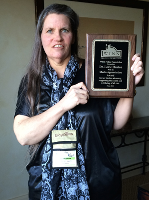 Dr. Lorie Huston showing off her Winn Foundation Media Appreciation Award (Photo: Steve Dale)