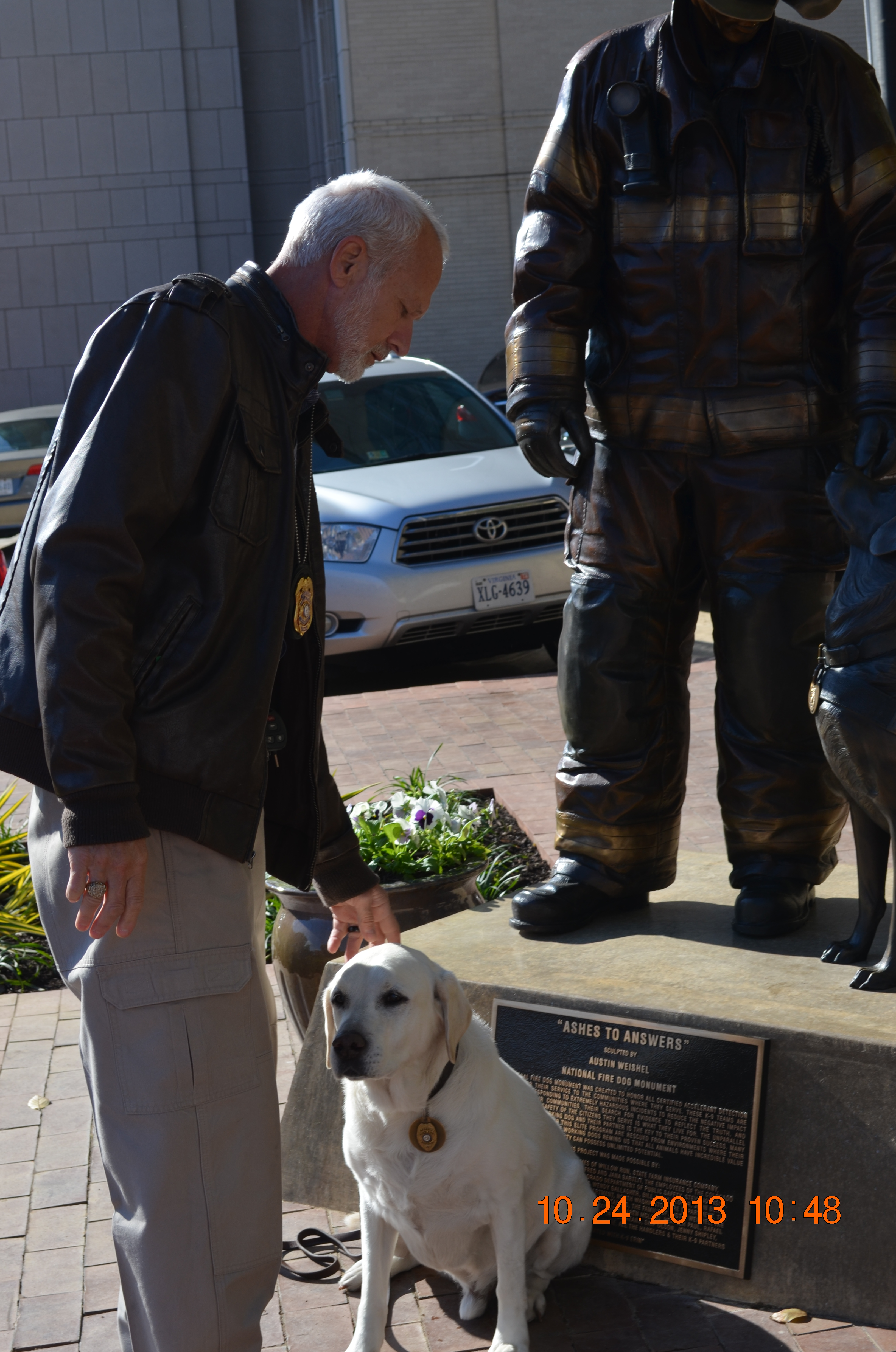 Investigator Gourley and K-9 Cotton at the National Fire Dog Monument in Washington, DC.