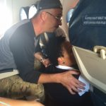 Paul assisting one of the flight attendants as she took vitals on the man.
