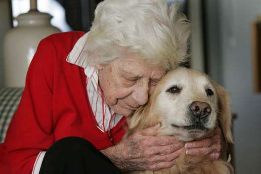 senior-woman-hugs-golden